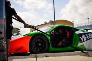 Crews unload the #458 MP1A Ferrari 458 GT3 driven by Carlos Zaid of NGT Motorsports