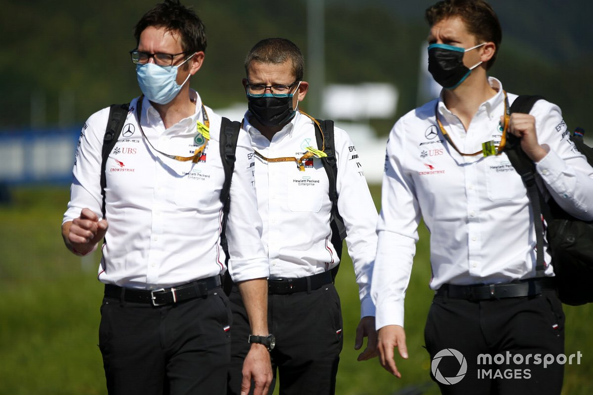 Members of the Mercedes F1 team Performance arrive at the track.