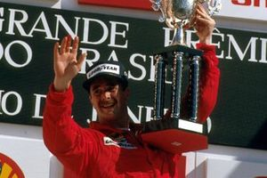 Race winner Nigel Mansell, Ferrari 640 on his debut race for Ferrari, celebrates on the podium
