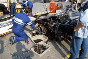 Mechanics work on a March 821 Ford
