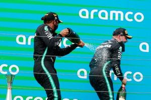Lewis Hamilton, Mercedes-AMG Petronas F1, and Valtteri Bottas, Mercedes-AMG Petronas F1, spray champagne on the podium
