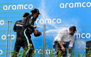 Lewis Hamilton, Mercedes-AMG Petronas F1, 1st position, and Valtteri Bottas, Mercedes-AMG Petronas F1, 3rd position, on the podium