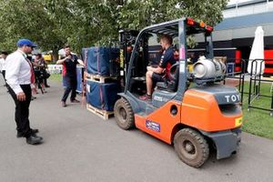 Red Bull personnel pack away their equipment
