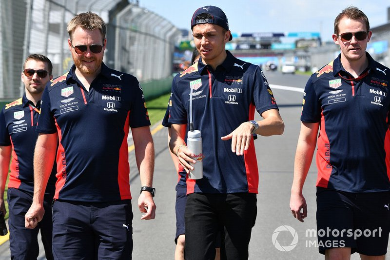 Alex Albon, Red Bull Racing walks the track with members of his team
