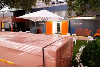 Packing crates outside the McLaren garage in the paddock