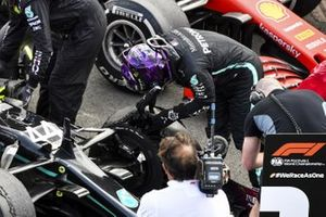 Race Winner Lewis Hamilton, Mercedes-AMG F1 looks at the damage to his car from a puncture in Parc Ferme