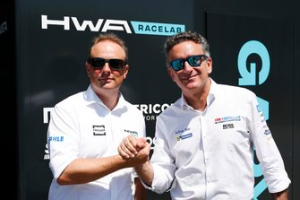 Alejandro Agag, CEO, Formula E shakes hands with Ulrich Fritz, CEO of HWA AG