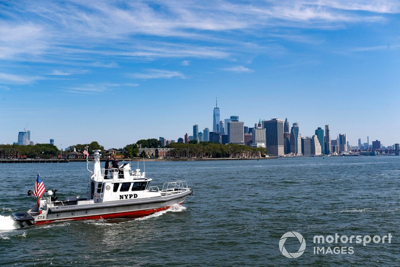 New York Police Department boat past the skyline