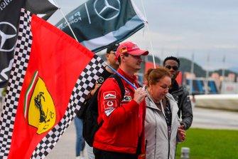 A fan carries a Ferrari flag