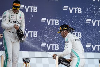 Valtteri Bottas, Mercedes AMG F1, 2nd position, and Lewis Hamilton, Mercedes AMG F1, 1st position, celebrate with Champagne on the podium