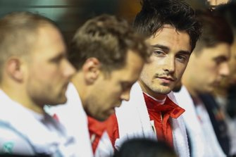 Valtteri Bottas, Mercedes AMG F1, Sebastian Vettel, Ferrari, and Charles Leclerc, Ferrari, lined up for the national anthem prior to the start