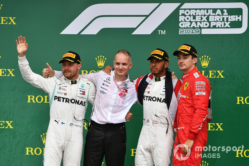 Valtteri Bottas, Mercedes AMG F1, 2nd position, the Mercedes Constructors trophy recipient, Lewis Hamilton, Mercedes AMG F1, 1st position, and Charles Leclerc, Ferrari, 3rd position, on the podium