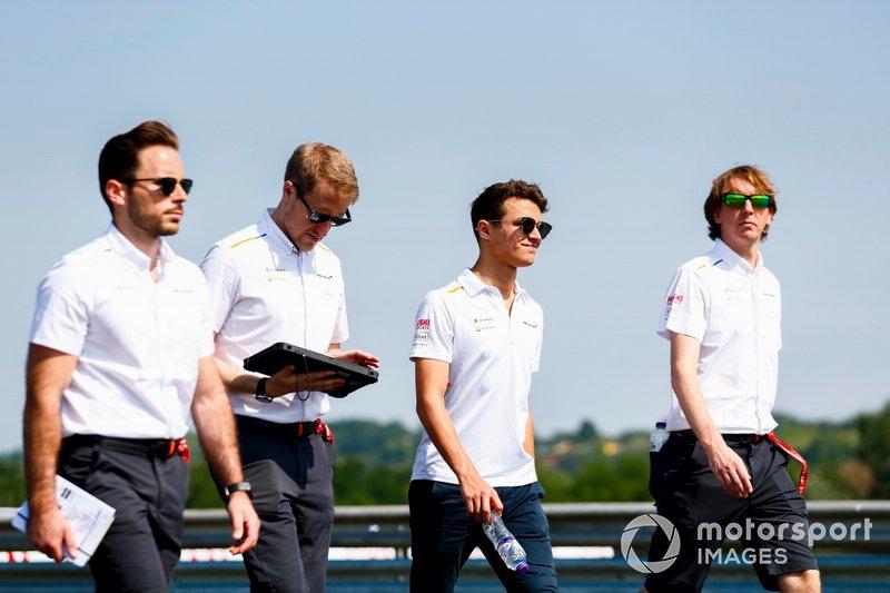 Lando Norris, McLaren walks the track with his team