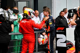Sebastian Vettel, Ferrari and Race winner Max Verstappen, Red Bull Racing celebrate in Parc Ferme