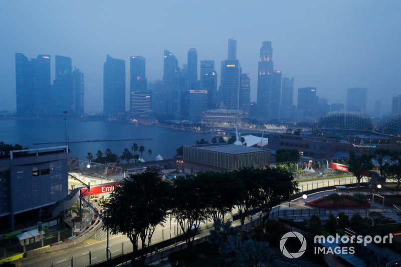 A scenic view of the Singapore skyline on an overcast day