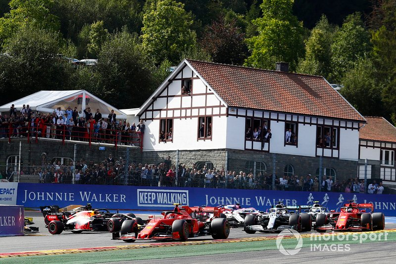 Charles Leclerc, Ferrari SF90, leads Sebastian Vettel, Ferrari SF90, Lewis Hamilton, Mercedes AMG F1 W10 and Valtteri Bottas, Mercedes AMG W10. Kimi Raikkonen, Alfa Romeo Racing C38 has just been tipped into the air by Max Verstappen, Red Bull Racing RB15