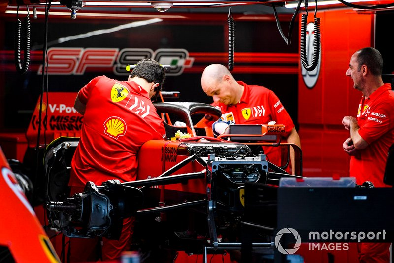 Ferrari mechanics prepare the car of Sebastian Vettel, Ferrari SF90, for wet weather, in the garage
