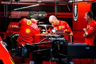 Ferrari mechanics prepare the car of Sebastian Vettel, Ferrari SF90, for wet weather, in the garage