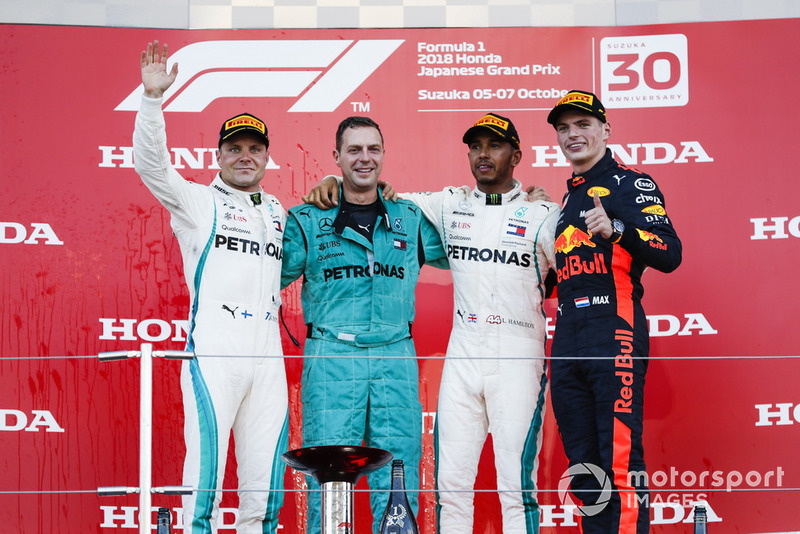 Second place Valtteri Bottas, Mercedes AMG F1, the Mercedes Constructors trophy delegate, Race winner Lewis Hamilton, Mercedes AMG F1,and third place Max Verstappen, Red Bull Racing, on the podium