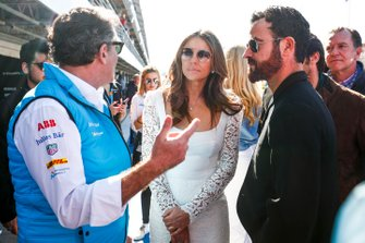 Alejandro Agag, CEO, Formula E, gives a tour to actors Elizabeth Hurley, Justin Theroux