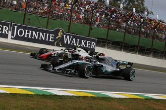 Kevin Magnussen, Haas F1 Team VF-18 and Valtteri Bottas, Mercedes AMG F1 W09 EQ Power+ battle