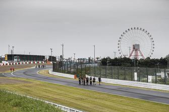 Romain Grosjean, Haas F1 Team, walks the track with his team.