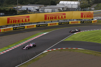 Esteban Ocon, Racing Point Force India VJM11 and Kevin Magnussen, Haas F1 Team VF-18
