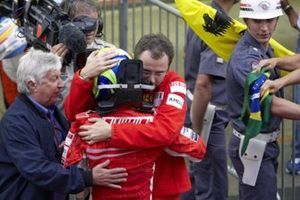 Ferrari's Stefano Domenicali and FIA race observer Herbie Blash console a Felipe Massa after the race
