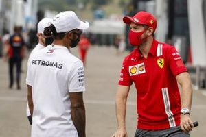 Lewis Hamilton, Mercedes-AMG F1 and Sebastian Vettel, Ferrari chat in the paddock