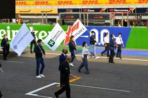 Flags of F1, the Lombardie region and the Automobile Club d' Italia are flown on the grid at the end of the race