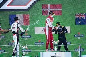 Theo Pourchaire, ART Grand Prix, Race Winner Frederik Vesti, Prema Racing and Oscar Piastri, Prema Racing celebrates on the podium with the champagne