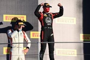 Nikita Mazepin, Hitech Grand Prix, 1st position, and Luca Ghiotto, Hitech Grand Prix, celebrate on the podium