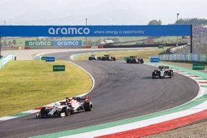 Kimi Raikkonen, Alfa Romeo Racing C39, Romain Grosjean, Haas VF-20, and Charles Leclerc, Ferrari SF1000