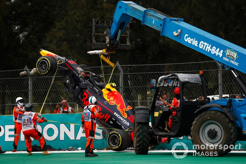 Car of Alex Albon, Red Bull RB15 being recovered after crashing in FP2