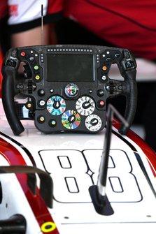Steering wheel detail of an Alfa Romeo Racing C39