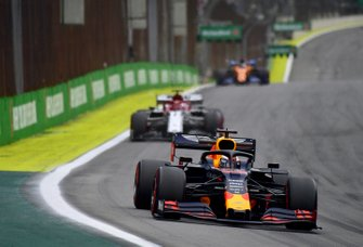 Max Verstappen, Red Bull Racing RB15, leads Kimi Raikkonen, Alfa Romeo Racing C38