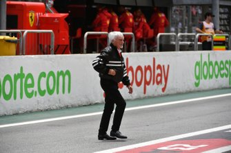 Bernie Ecclestone, Chairman Emiritus of Formula 1, crosses the pit lane