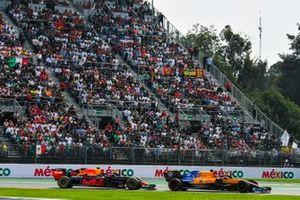 Carlos Sainz Jr., McLaren MCL34, leads Max Verstappen, Red Bull Racing RB15