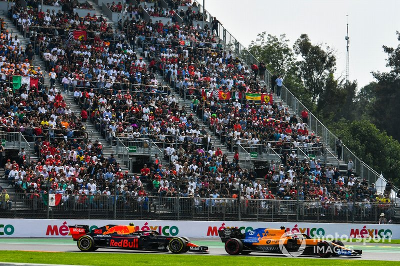 Carlos Sainz Jr., McLaren MCL34, leads Max Verstappen, Red Bull Racing RB15