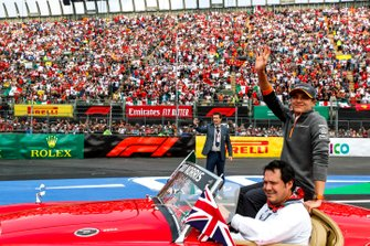 Lando Norris, McLaren, waves to the fans during the drivers parade