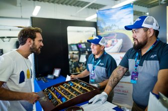 Jean-Eric Vergne, DS Techeetah talks to the Maui Jim representatives about their sunglasses in the DS Techeetah garage