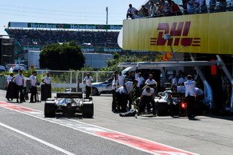 Valtteri Bottas, Mercedes AMG W10, and Lewis Hamilton, Mercedes AMG F1 W10, in the pit lane