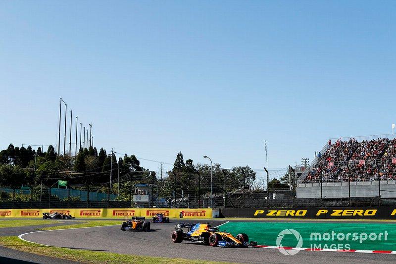 Carlos Sainz Jr., McLaren MCL34, leads Lando Norris, McLaren MCL34, Pierre Gasly, Toro Rosso STR14, and Romain Grosjean, Haas F1 Team VF-19, on the formation lap