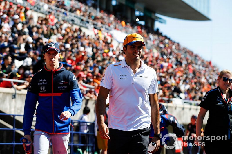 Carlos Sainz Jr., McLaren, and Daniil Kvyat, Toro Rosso, in the drivers parade
