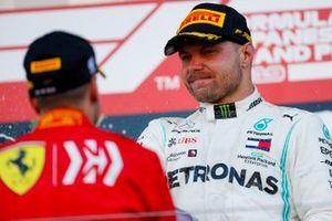 Race winner Valtteri Bottas, Mercedes AMG F1 and Sebastian Vettel, Ferrari celebrate on the podium with the champagne