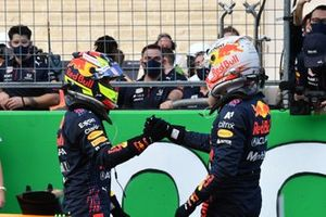 Sergio Perez, Red Bull Racing, and pole man Max Verstappen, Red Bull Racing, congratulate each other in Parc Ferme