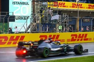 Lewis Hamilton, Mercedes F1 W11, passes the chequered flag