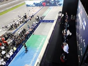 Max Verstappen, Red Bull Racing, 2nd position, Lewis Hamilton, Mercedes, 1st position, and Valtteri Bottas, Mercedes, 3rd position, on the podium, with their teams gathered beneath