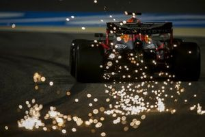 Sparks fly from the rear of Max Verstappen, Red Bull Racing RB16
