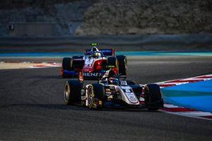 Christian Lundgaard, ART Grand Prix, leads Robert Shwartzman, Prema Racing
